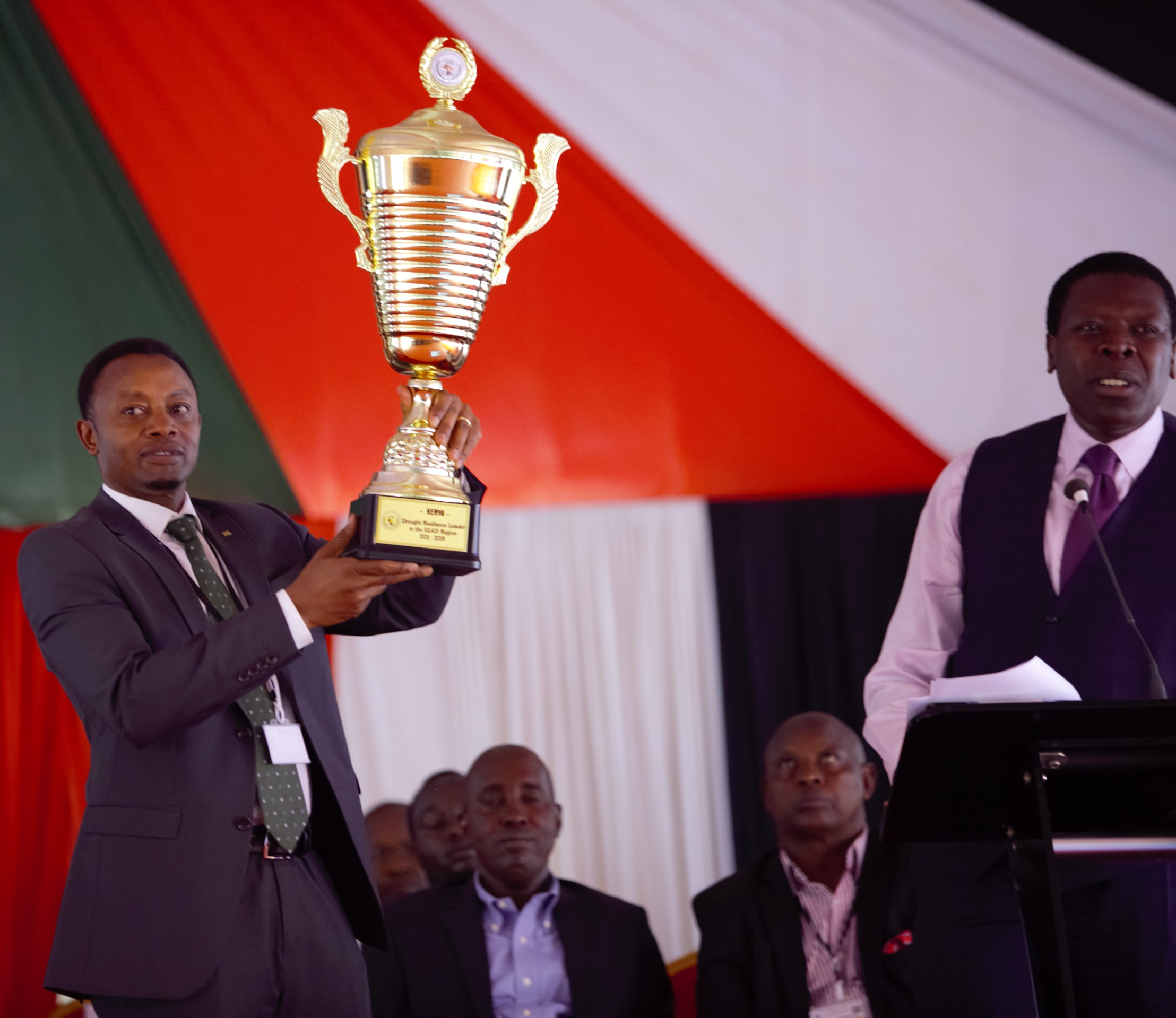 NDMA Board Chairman Mr Raphael Nzomo shows off the IGAD Resilience Champion Award presented to him by Devolution and ASALs Cabinet Secretary Hon. Eugene Wamalwa during the opening of the 2nd ASALs Conference in Kajiado County on September 10, 2019. The award recognises Kenya as a resilience building champion in the region, especially for institutionalising drought management through establishment of the NDMA. The NDMA coordinates the Ending Drought Emergencies strategy on behalf of the Government.