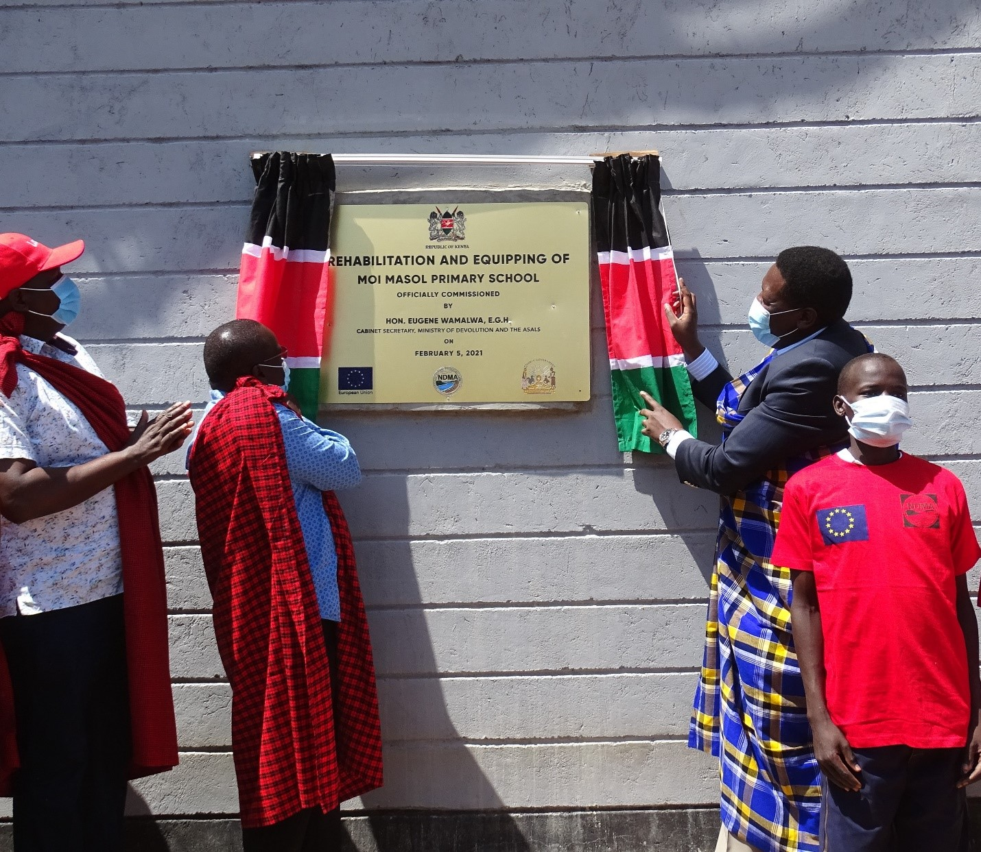 Devolution and Asals Cabinet Secretary Hon. Eugene Wamalwa unveils a commemorative plaque at Moi Masol Primary School in West Pokot County. With him are State Department for Development of ASALs Principal Secretary Mr. Micah Powon and Area MP Mr. Peter Lochakapong. The school was rehabilitated and equipped at a total cost Ksh 42.6 million of which the NDMA contributed Ksh 27.5 million with financial support of the European Union while West Pokot County Government contributed Ksh13.2 million and the Akiriamet Community gave Ksh1.95 million.